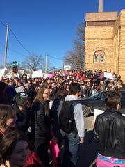Students take to Walker Street outside of East High School during a protest against Westboro Baptist Church on Monday.