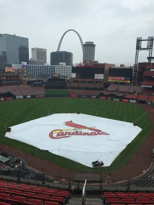 The tarp was out at Busch Stadium on Sunday afternoon before the Reds' scheduled night game against the Cardinals.