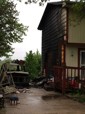 Des Moines fire officials say a fire at a south-side duplex may have started in a van parked in its driveway.