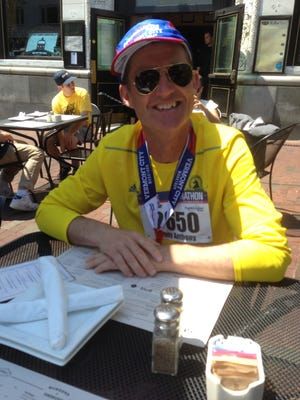 """On his first trip to Burlington, Tony O'Flaherty ran in Sunday's People's United Bank Vermont City Marathon. """"Burlington is a beautiful city,"""" O'Flaherty said, at a post-race meal at RiRa's. """"I want to move here."""""""