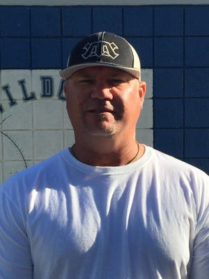 Jeff Holland, of Gilbert Mesquite, is azcentral sports' big schools baseball coach of the year.