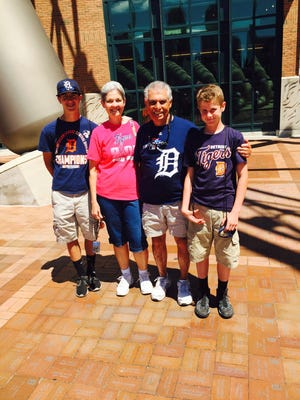 Brett Chesla, far left, and brother Devin Chesla talk about Tigers trade options today outside Comerica Park along with their grandfather Dick Ricci.