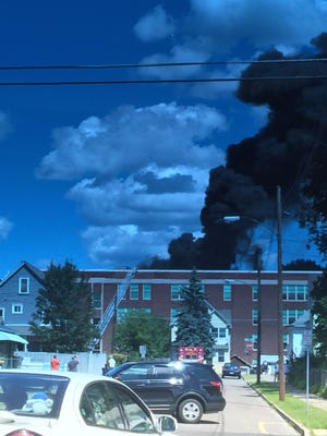 Thick black smoke from a fire at East Middle School in Binghamton is visible from Route 17.