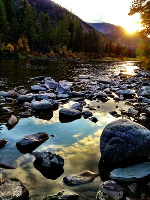 The sun sets on a Blackfoot River fishing access site. The Land and Water Conservation Fund has helped purchase about 70 percent of Montana's fishing access sites.
