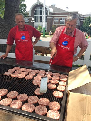 Rep. Steve King, left, and Gov. Terry Branstad step up to the grill at the Iowa Pork Tent on Opening Day of the 2015 Iowa State Fair.