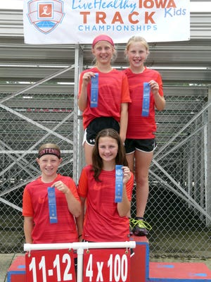 Participants show their ribbons at the Live Healthy Iowa Kids State Track meet in Marshalltown.