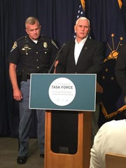 Gov. Mike Pence (right) announced a new drug abuse task force Sept. 1, 2015.