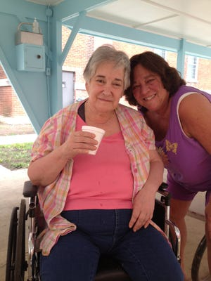Carole Scalise, left, and her sister Janice, who is her guardian. Carole was transferred from the state mental hospital at Clarinda to the Perry Health Care Center in June. She recently was transferred again to another nursing home near Bloomfield.