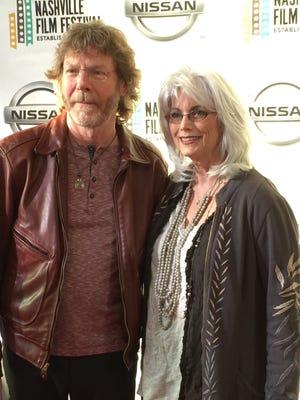 Sam Bush and Emmylou Harris pose on the 2015 Nashville Film Festival red carpet.
