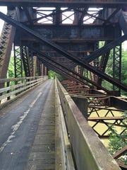 Back when this Lehigh Valley line was active, trains thundered over the top of the bridge at Wadsworth Junction over the Genesee River. Now hikers, cyclists and horseback riders pass through the supports underneath in a nifty bit of re-engineering in Rush.