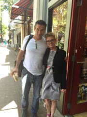 Billy Baldwin is pictured with Greenville's Harlena Walters in downtown Greenville on Thursday.