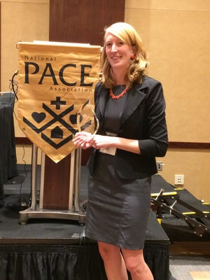 Becky Hille receives the 2015 Nurse of the Year award on Oct. 18, during the National PACE conference in Philadelphia.