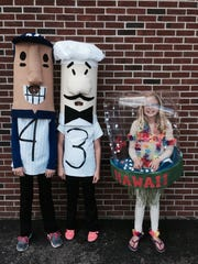 Elkhart Lake-Glenbeulah Middle School students participated in a costume contest as part of the Halloween activities last month. Winners included sixth-graders Haley Mersberger and Malorie Prigge as racing sausages and fifth-grader Ava Stroessner as a snow globe of Hawaii.