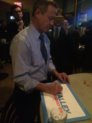 Martin O'Malley meets with supporters at Saints Pub in Des Moines after Saturday's Democratic presidential debate.