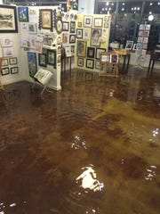 About three inches of water covered the 5,000-square-foot floor in ZaPow Gallery on  Nov. 18.