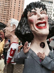"The new ""Big Head"" of the late actress Gilda Radner finishes the Thanksgiving Day parade in Detroit, with   Red Wings hockey legend Gordie Howe in background"