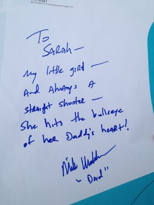 After target shooting at a range in Johnston, Mike Huckabee penned a note to his daughter, Sarah Huckabee Sanders.