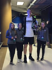 Purdue center Isaac Haas poses with ball girls at Pepsi Center in Denver after Wednesday's open practice.