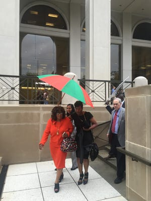 US Rep Corrine Brown, D-Jacksonville, leaves the federal courthouse today after a hearing on her legal challenge to Florida's congressional redistricting. A three-judge panel heard her argument that a new district configuration running from Jacksonville to Gadsden County dilutes black voting strength.