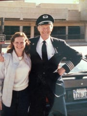 American Airlines Captain Andy Anderson poses with his daughter Laura Bergstrom in a 1987 photo. Twenty-nine years later, Anderson wore the same uniform while pinning wings on granddaughter Katie Anderson when she graduated March 25 from AA's flight attendant school.