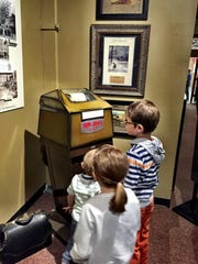 Kids at Sunday's museum sampler enjoyed this downtown Great Falls exhibit at the History Museum that included a Dow-Jones ticker tape machine that spat out stock prices in the days before computers.