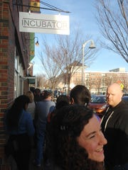 People wait in line outside Incubator in Winooski for