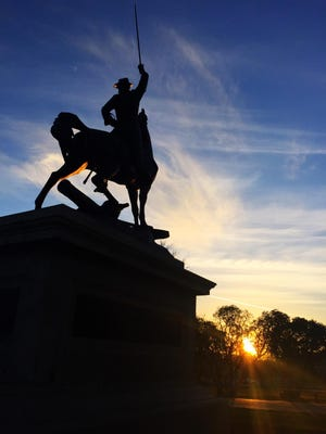 The sun sets against the Thomas F. Meagher statue at the Montana Capitol in Helena. Seeing the statue is just one of the ways to interact with Meagher's Montana legacy.