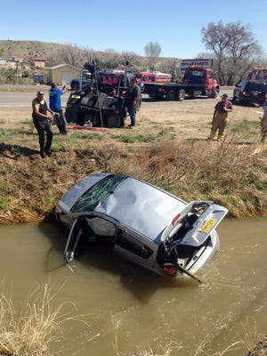 San Juan County Sheriff's Office deputies, paramedics and Good Samaritans worked on Thursday to rescue a mother and daughter from a car that was submerged in an irrigation ditch near Aztec.