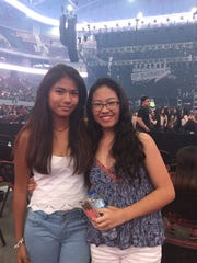 Julie Noreen Quibuyan, left, and Jonette Guteirrez attend the 5 Seconds of Summer concert held in Manila.