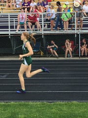 Oak Harbor's Annie Quisno competes in the 800 on Saturday at regionals.