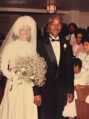 Debra White-Hunt on her wedding day with her father, Sylvester White
