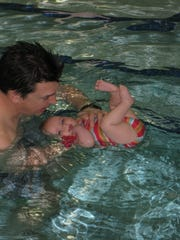 Dad Andre and daughter Ellie take swim lessons.