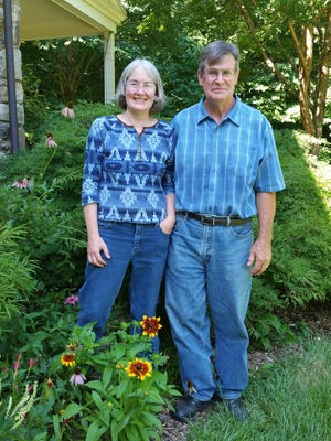 Jeanne and John Frett stand at their home on 19 acres in Landenberg, Pa.