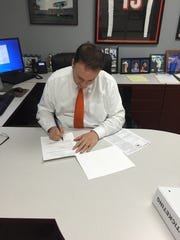 In this photo from the fall of 2015, Jeff Berding signs FC Cincinnati's first-ever player contracts.