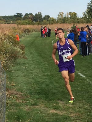 Mount Gilead's Austin Hallabrin runs his way to his third straight Mid Ohio Athletic Conference Blue Division championship in boys cross country Saturday morning at Harding High School.