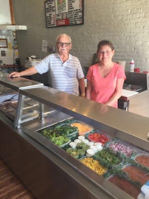 Gary Davis of Ripley and Tonya Shelton of Higginsport serve burritos at Ripley's Gourmet Tortillas