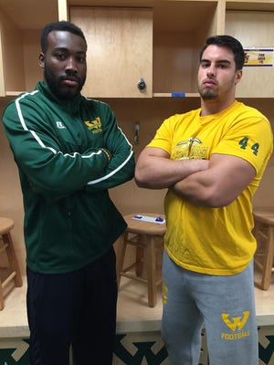 Redshirt senior linebackers Valorian Cunningham, left, and Anthony DeDamos are close friends and leaders of the Wayne State Warriors defense.