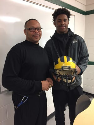 Detroit Cass Tech football coach Thomas Wilcher, left, poses with receiver Donovan Peoples-Jones on Friday, Dec. 16 at Cass Tech in Detroit.