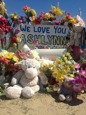 Brightly colored bouquets and toys decorate a memorial site established on Navajo Route 36, near the Lower Fruitland home of 11-year-old Ashlynne Mike.