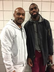 Pistons assistant coach Tim Hardaway, left, with his son, Tim Hardaway Jr., a guard for the Atlanta Hawks and ex-Michigan Wolverine, after the Pistons defeated the Hawks, 118-95, on Jan. 18, 2017 at the Palace.