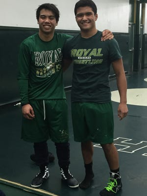 Royal High sophomore wrestlers Gerry Fulgentes (right) and Aidan Carrillo have been friends since they competed against each other in a judo match when they were 5 years old.