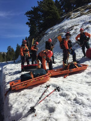 Members of the Ventura County Sheriff's East Valley Search and Rescue Team prepare to search for  fallen hikers in the San Gabriel Mountains.