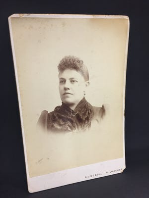 A portrait of Flora Wright Jaffery was purchased for 50 cents at the Willamette Humane Society Thrift Store in Salem. Handwritten on the back of the photo is a family history.