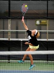 Abilene High's Lauren Schaeffer serves the ball during