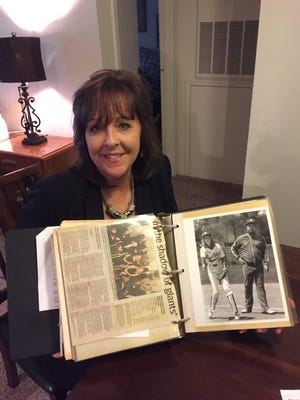 Elise Spears' scrapbook includes a photo of her as a Hamilton player with her father, Big Blue coach John Spears.