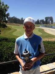 Jake Marek poses with the trophy he won for winning the VCJGA tournament on Mother's Day 2013. Marek told his dad he was going to win to honor his mom who had died from cancer six months before.