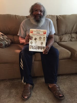 Carl Ward shows off the program from his 1980 induction into the LaRosa's Sports Hall of Fame.