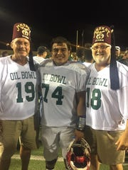 Jaden Cerda meets with Shriner Divans while playing in the 80th Maskat Shrine Oil Bowl.