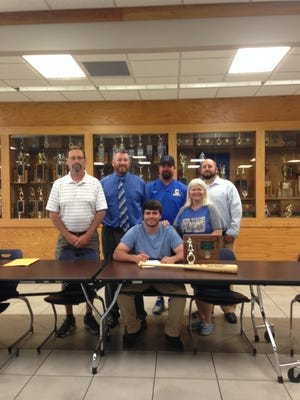 Clyde graduate Ryan Kelley, sitting, will play baseball at Tiffin University. Kelley is joined by father, John Kelley, Clyde coach George Parks, assistant coach Shane Cook, mother, Barb Kelley and assistant coach Jason Haughawout.