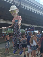 A 14-foot-tall Hunter S. Thompson -- the author and journalist born in Louisville -- was one of two puppets being carried around the festival by Squallis Puppeteers, a local nonprofit